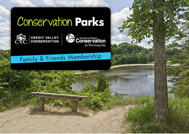 The Conservation Parks family and friends membership card superimposed on a view of a lake from the top of a hill
