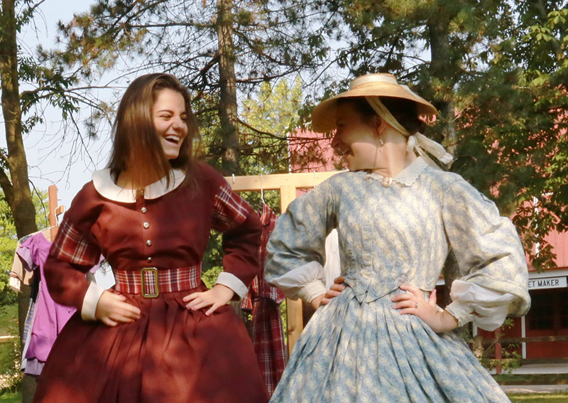 Two pioneer women in dresses