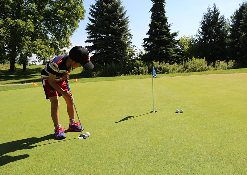 A boy on the putting green